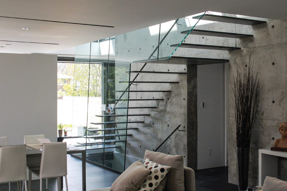 wall cantilevered / steel only steps / floor to ceiling glass / wall mount handrail / blackened steel handrail