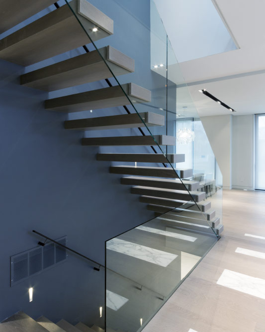 wall cantilevered / box steps / blackened steel handrail