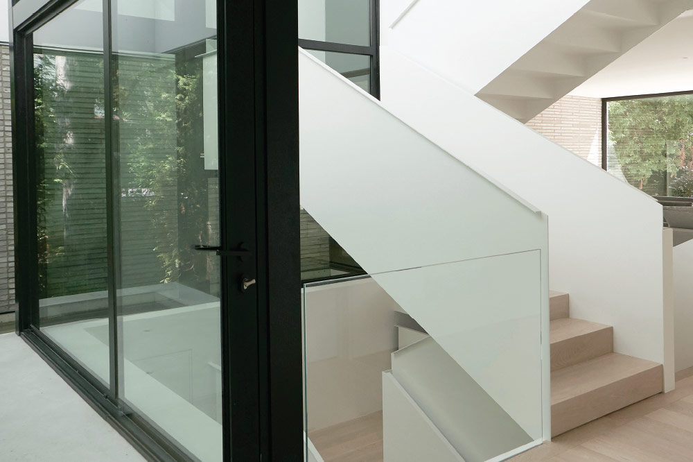 zig zag stair with solid steel guards / painted steel / wood waterfall steps