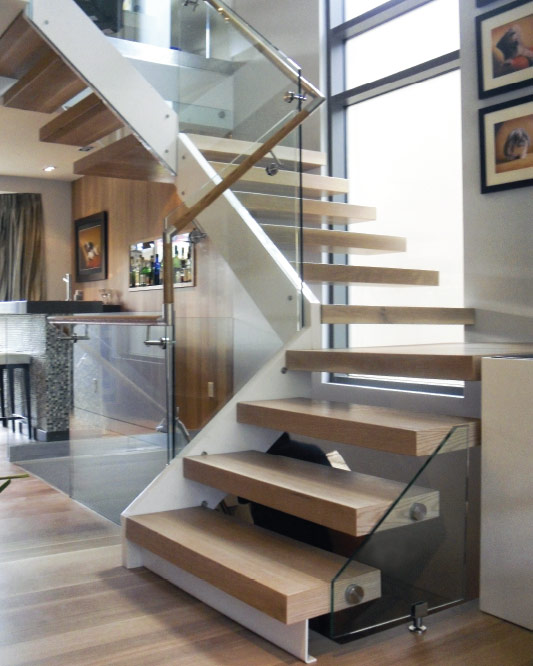 stringer cantilevered / box steps / oak box landing / glass side mount handrail / round wood handrail