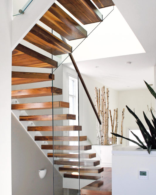 wall cantilevered / stringer visible / winder / walnut box steps / top mount handrail