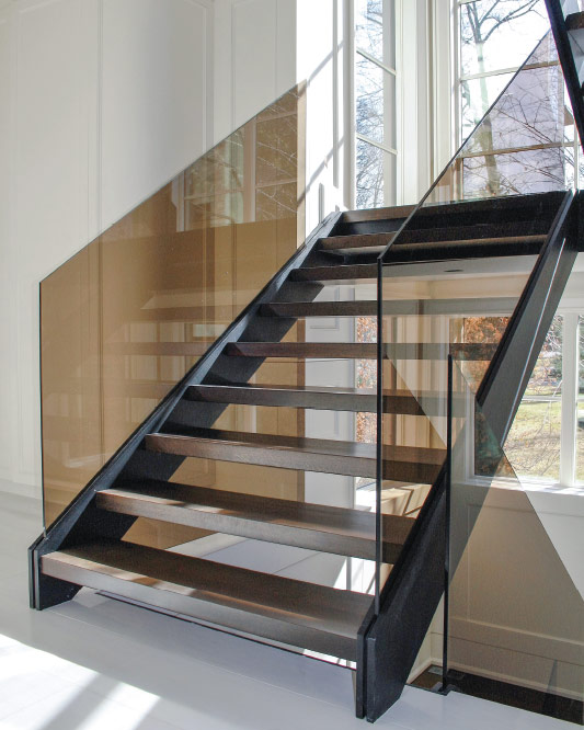 side stringers / black anodized aluminum stringers / bronze tinted glass / box wood steps