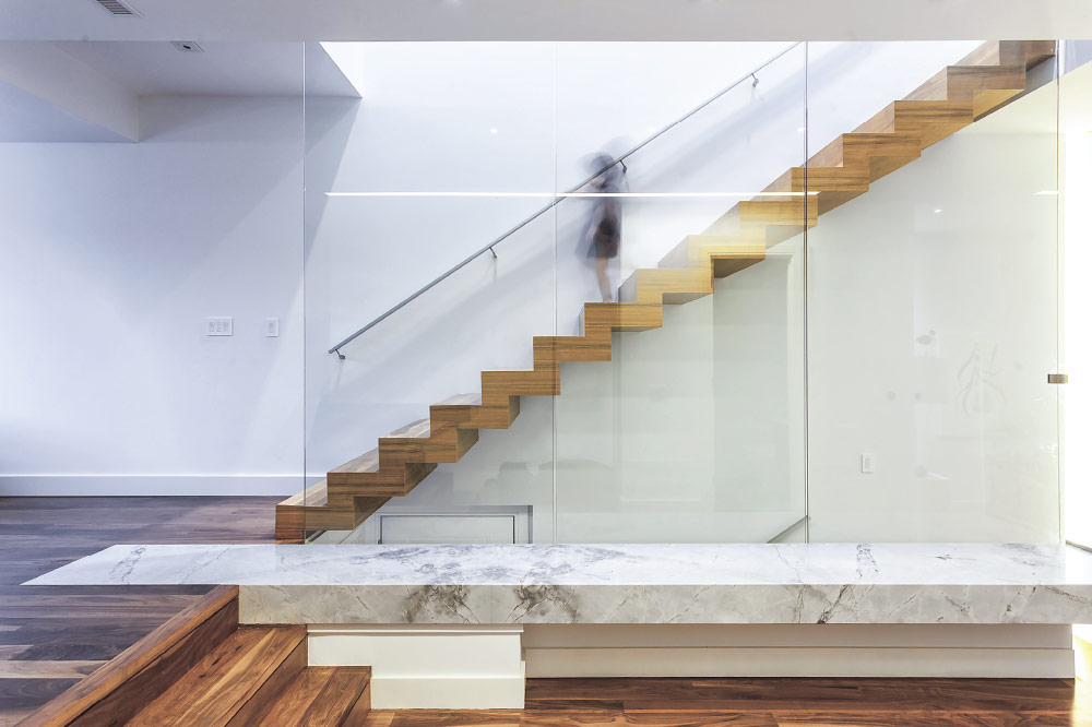 zig-zag stair / floor to ceiling glass / wall mount handrails / solid aluminum handrails